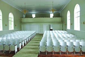 Riverside House auditorium still sports the original seating, but now with a central aisle more conducive to weddings