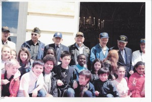Bob Hall, back row center, with fellow veterans and French children