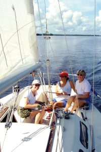 Terry Osman, Marianne Gruber and Tina Brady aboard Osman's boat, Expression