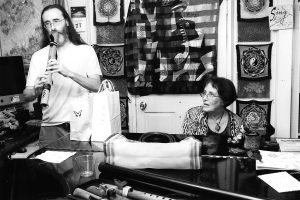 Keith Molineaux and Gina Martinelli perform a duet in her home, 2016