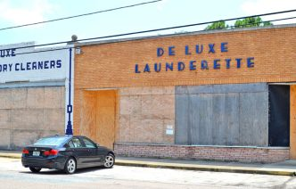 Fate of former Deluxe Laundry and Cleaners building still uncertain