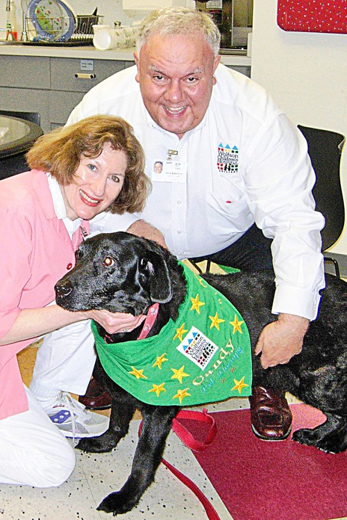 Catie and Dick Wallace with therapy dog, Candy